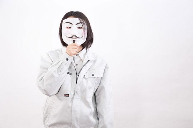仮面を付けた会社員の写真